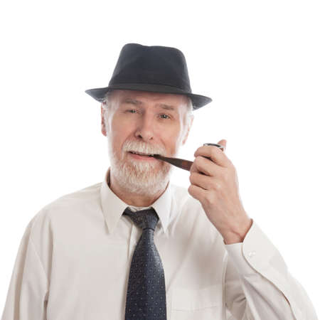 pensioner: Senior with hat and pipe smoking on white background Stock Photo