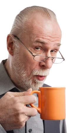 Senior the cup of tea closeup isolated photo