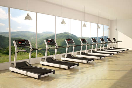Gym with windows and running machines with wooden floor photo