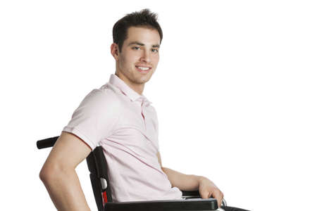 paralysis: Young professional looking into camera isolated on white with wheelchair Stock Photo