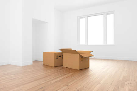 moving office: Boxes in empty room Stock Photo