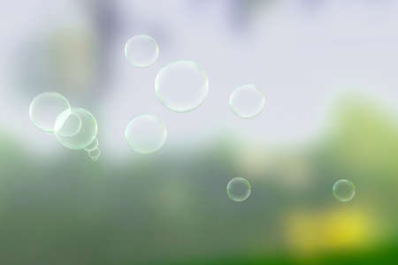 Bubbles on a summers day with green background photo