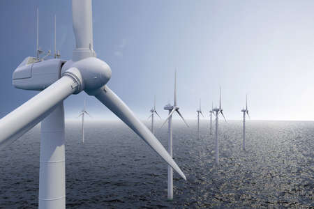 Wind park on ocean with blue sky photo