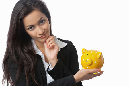 economise: Asian Businesswoman presenting piggy bank isolated on white Stock Photo
