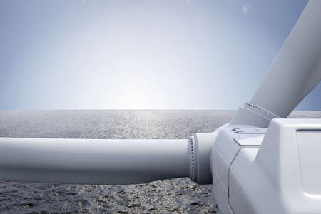 Windpark with ocean and sun over the horizon photo
