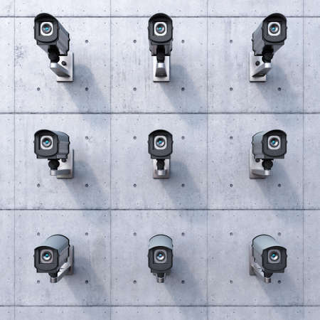 close circuit camera: nine security cameras on a concrete wall