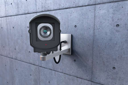 close circuit camera: security camera looking at you on concrete wall