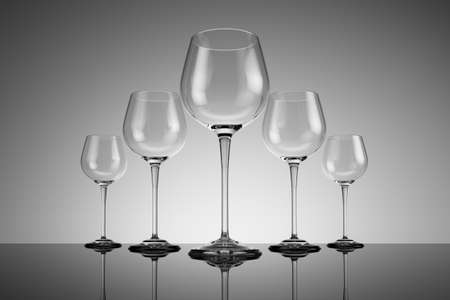 receptacle: Row of wine glasses on reflective ground Stock Photo