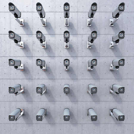 video surveillance: 25 cctv camera watching you on concrete wall Stock Photo