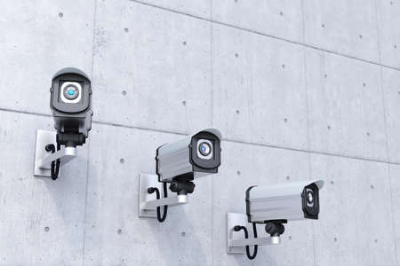 close circuit camera: security cameras with copyspace top right on concrete wall