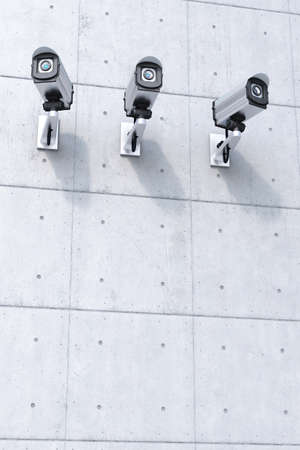 Three Security camera with copyspace bottom on concrete wall Stock Photo - 16433341