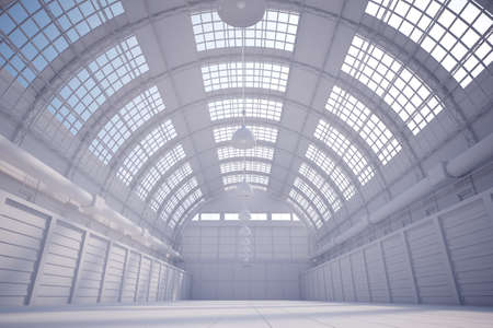 warehouse interior: White hangar with bright sky coming trough the ceiling Stock Photo