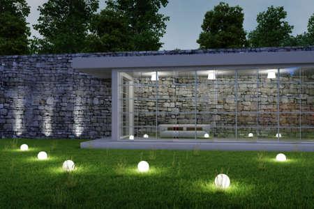 Tuinarchitectuur bij nacht met gloeiende bollen in gras Stockfoto