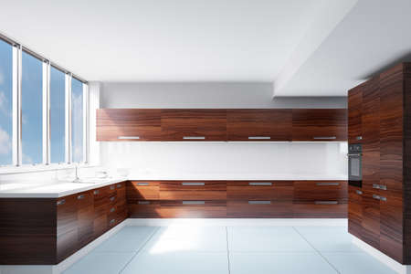 worktops: Kitchen in sunlight with white walls and sink