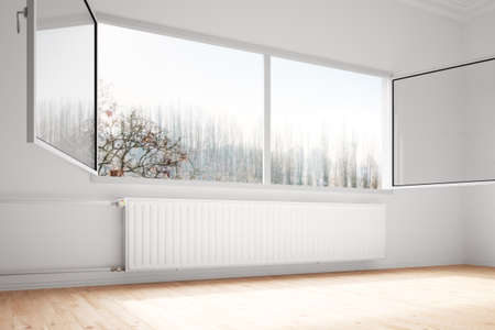 and heating: Central heating attachted to wall with open windows Stock Photo