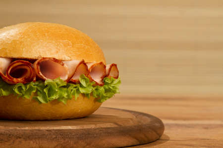 cured ham: Crisp bred on wodden dish on a table low angle Stock Photo