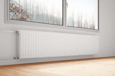 radiador: Calefacción attachted a la pared con las ventanas cerradas Foto de archivo