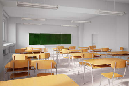 Old school classroom with wooden seats and tables photo