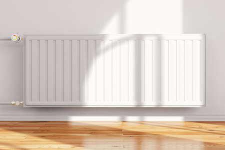 and heating: Heatingsystem attached to wall frontal with hardwood floor Stock Photo
