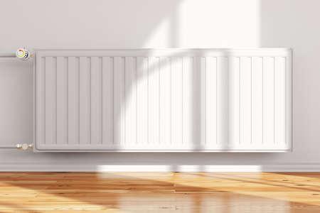radiador: Heatingsystem unido a la pared frontal con piso de madera Foto de archivo