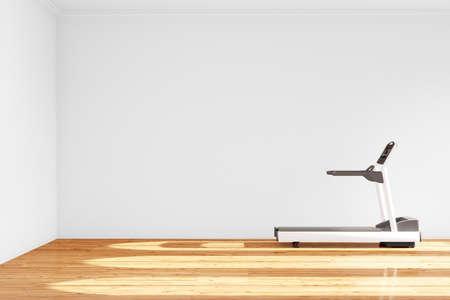 Treadmill in empty room with hardwood floor photo