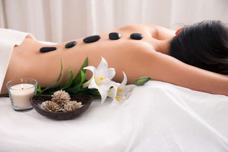alternative therapies: Hot Stone wellness treatment with decoration