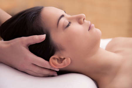 health resort treatment: Acupuncture treatment in the head of an asian woman