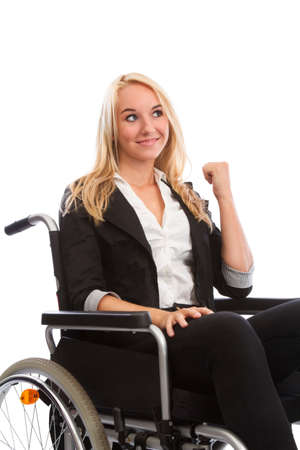 incapacitated: Blond girl sitting in a wheel chair smiling Stock Photo