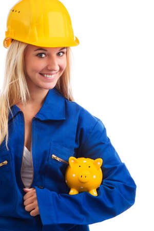 woman engineer: Female engineer with piggy bank isolated on white