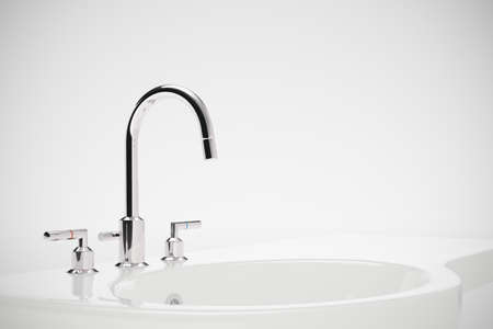 Ceramic sink with chrome fixture on white background photo