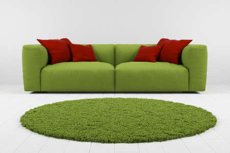 Green sofa with carpet in grey room closeup photo