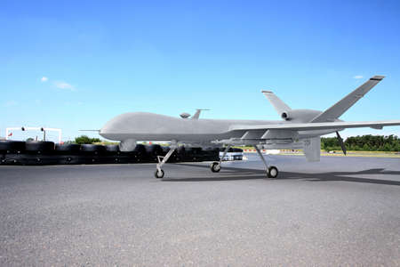 payload: Predator comabt drone on ground with blue sky