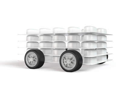 medical distribution: Pack of pills with car wheels attached Stock Photo