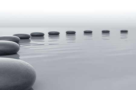 zen stones: Stones in water forming a circle towars the horizont Stock Photo