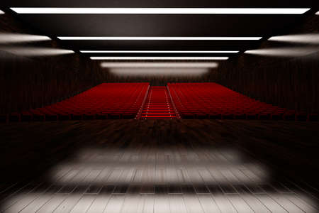 onstage: Empty concert hall with red seats and hardwood floor Stock Photo