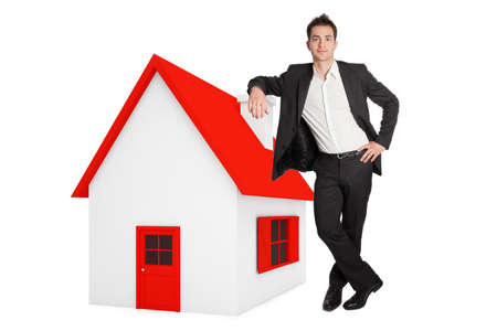 Man leaning on a minitaure house white background photo