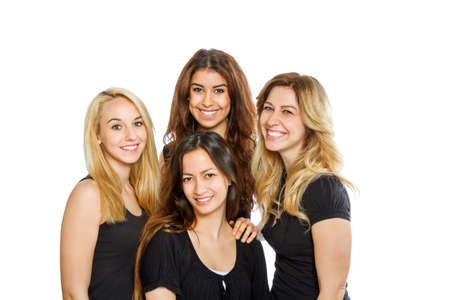 Four girls smiling in the camera isolated on white background photo