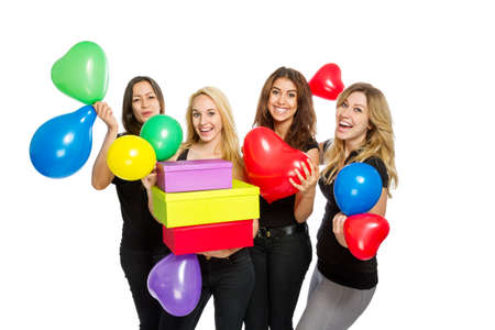 merrymaking: Girls having a party with baloons on white background