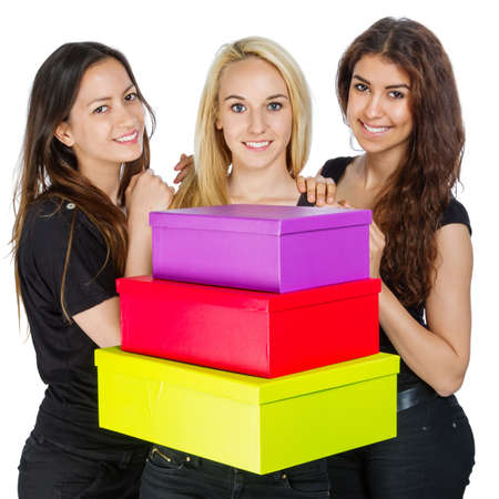 three gift boxes: Three Girls with colorful boxes on white background Stock Photo