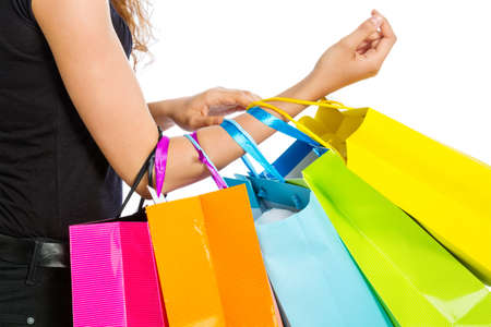 spendthrift: Arm with shopping bags on white background