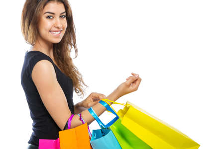 spendthrift: Girl with a lot of shopping bags on white background Stock Photo