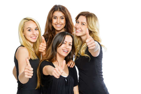 Group of girls with thumbs up isolated on white photo