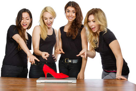 Four girls with laptop and red shoe on white backgroudn photo