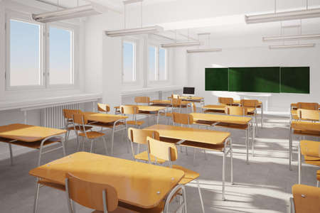 seating furniture: Old classroom with modern computer and green board Stock Photo