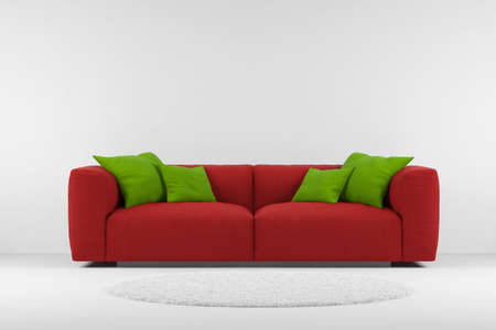 couch: Red couch with carpet and green pillows