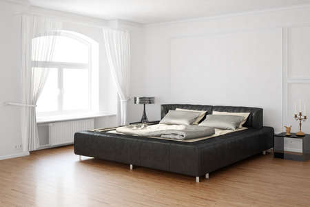 Sleeping room with bed and hardwood floor Standard-Bild