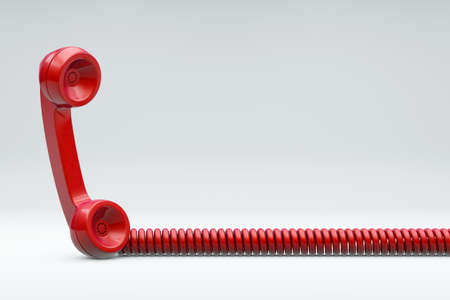 Red Telephone with cord on grey background photo