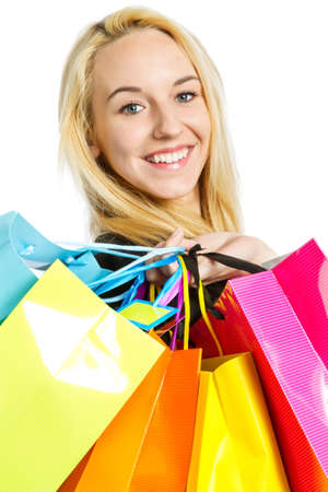 Girl with shopping bags isolated on white background Stock Photo - 20995287