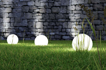 Glowing light in the grass with old wall in background