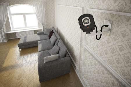 CCTV 카메라와 회색 소파가있는 거실